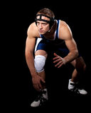 Wrestler. In a blue singlet. Studio shot over black Stock Image
