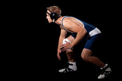 Wrestler. In a blue singlet. Studio shot over black Stock Photo