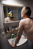 Wrestler in mirror. A humorous portrait of a man seeing himself as a wrestler in a mirror Stock Image