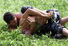 Wrestlers engaged in a fierce battle at the Kirkpinar Turkish Oil Wrestling Festival at Edirne in Turkey. Wrestlers engaged in a fierce battle amonst the long stock image