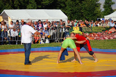 Wrestlers fight on ring Stock Images