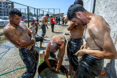 Wrestlers oil their bodies prior to competing at the Elmali Turkish Oil Wrestling Festival in Elmali in Turkey. Elmali is a town located in the Taurus Mountains Stock Images
