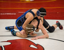 Wrestlers. Redding, California: Two wrestlers on the mat against each other in the NCSIF Wrestling Championships in northern California Stock Photography