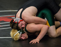 Wrestlers. Redding, California: Two wrestlers on the mat against each other in the NCSIF Wrestling Championships in northern California Stock Photo