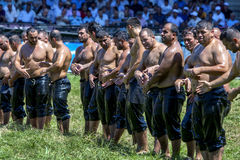 Wrestlers about to engage in battle at the Kirkpinar Turkish Oil Wrestling Festival in Edirne in Turkey. Kirkpinar is the most famous wrestling festival in Stock Image