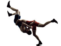 Wrestlers wrestling men isolated silhouette Royalty Free Stock Images