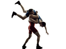 Wrestlers wrestling men isolated silhouette. Two caucasian wrestlers wrestling men on isolated silhouette white background stock photo