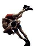 Wrestlers wrestling men isolated silhouette. Two caucasian wrestlers wrestling men on isolated silhouette white background stock photos