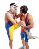 Wrestling. Male wrestlers. Studio shot over white Royalty Free Stock Photo