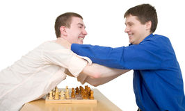 Wrestling boys ang chess Royalty Free Stock Images