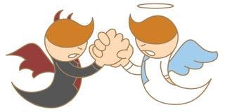 Wrestling de braço do anjo e do diabo Imagem de Stock Royalty Free