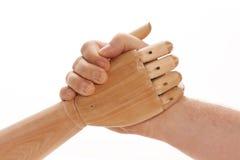 Wrestling de braço - ser humano contra Machi Fotografia de Stock