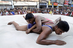 Wrestling Locked. Red wrestler locked the hand of blue wrestler at a wrestling championship held at Raja Katra, Kolkata on the occasion of Diwali stock photo
