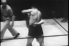 Wrestling match, New York City, 1930s stock video footage