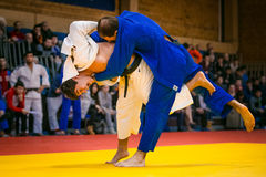 Wrestling match between young male judokas on tatami Stock Image