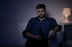 Wretched man with beer Royalty Free Stock Photography