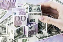 Würfel von Euro und von Dollar Stockbilder