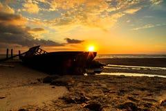 Wrick and Beautiful sunrise  at Tg Aru beach, Labuan. Malaysia. Wrick at Labuan Malaysia. with beautiful sunrise Stock Photography