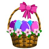 Wricked Easter basket filled with colored eggs. Isolated Royalty Free Stock Photo