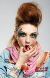 Wriggling glam punk girl. Portrait of glam punk redhead girl squeezes her cheeks Stock Photography
