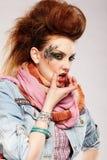 Wriggling glam punk girl Stock Photo