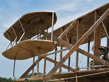 Wright Brothers Plane Replica. Orville Wright almost seems to come alive in this life-size replica of the brothers` famous plane. It is located on the site of royalty free stock image