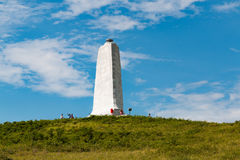 Wright Brothers Tower on Big Kill Devil Hill. KILL DEVIL HILLS, NORTH CAROLINA - JULY 14, 2017:  People visit the granite tower commemorating the achievements in Stock Photos