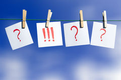 The wright choice. Question marks and an exclamation mark at a clothes line Royalty Free Stock Photos