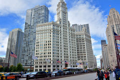 Wrigley Clock Tower and city street, Chicago. Wrigley building clock Tower in Chicago at North Michigan Avenue and the Michigan Avenue. Chicago, Illinois, United Stock Photo