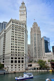 Wrigley Clock Tower and Tribune building beside Chicago river. Wrigley building clock Tower and Tribune building in Chicago at North Michigan Avenue and the Royalty Free Stock Photography