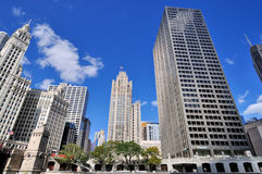 Wrigley clock tower, Tribune building and other buildings, Chicago. Wrigley building clock Tower and Tribune building, and other city buildings in Chicago at Royalty Free Stock Image