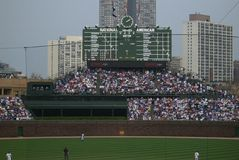 Wrigley Field - Famous Bleachers and Scoreboard Royalty Free Stock Image