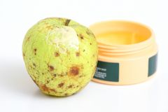 Wrinkle Care. Wrinkled apple with skin cream applied Stock Images
