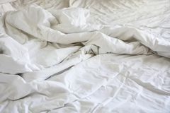 Wrinkle messy blanket in bedroom after waking up in the morning,. From sleeping in a long night Royalty Free Stock Photos