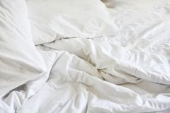 Wrinkle messy blanket in bedroom after waking up in the morning,. From sleeping in a long night Stock Image