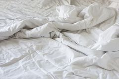 Wrinkle messy blanket in bedroom after waking up in the morning. From sleeping in a long night Stock Photography
