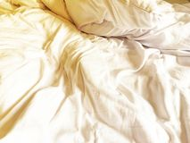 Wrinkle white soft blanket on the bed after wake up in the morning stock photos