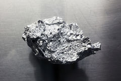 A wrinkled aluminum foil on the metal Royalty Free Stock Image