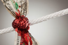 Wrinkled American Dollar Bleeding in Rope Royalty Free Stock Images