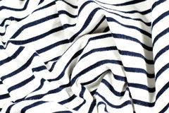 Wrinkled black and white striped fabric. As background Stock Photo