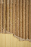 Wrinkled cardboard on wood Royalty Free Stock Photos