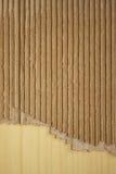 Wrinkled cardboard on wood royalty free stock photos