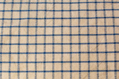 Wrinkled fabric background. Canvas style fabric in beige and blue Royalty Free Stock Images