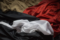 Wrinkled fabric, colored fabric, raw material, red, black, blue Royalty Free Stock Photo