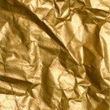 Wrinkled golden paper Stock Image