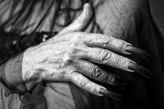 Wrinkled hand with long fingernails Stock Photos
