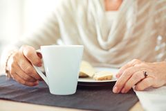 Wrinkled Hands with a Cup of Coffee Royalty Free Stock Image