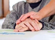 Wrinkled hands Stock Image
