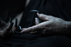 Wrinkled hands with long fingernails Stock Photography