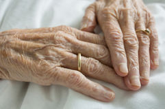Wrinkled hands. Of an old woman lying in bed Royalty Free Stock Image